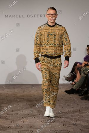 Stock Image of A model presents creation by designer Marcel Ostertag during the Berlin Fashion Week, in Berlin, Germany, 15 January 2020. The Fall/Winter 2020 collections are presented at the Berlin Fashion Week from 13 to 17 January.