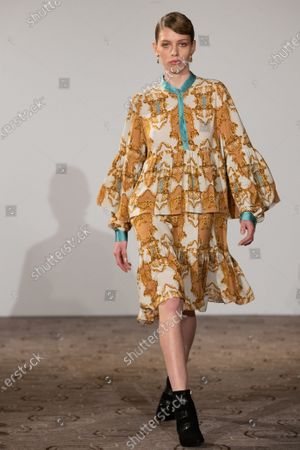 Stock Photo of A model presents creation by designer Marcel Ostertag during the Berlin Fashion Week, in Berlin, Germany, 15 January 2020. The Fall/Winter 2020 collections are presented at the Berlin Fashion Week from 13 to 17 January.