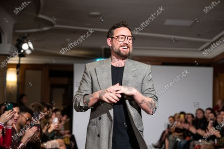 Designer Marcel Ostertag appears on the runway at the end of his show during the Berlin Fashion Week, in Berlin, Germany, 15 January 2020. The Fall/Winter 2020 collections are presented at the Berlin Fashion Week from 13 to 17 January.