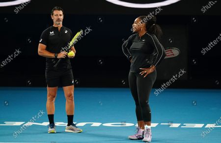 Serena Williams of the United States (R) talks with her coach Patrick Mouratoglou (L) during an Australian Open practice session at Melbourne Park in Melbourne, Australia, 16 January 2020.