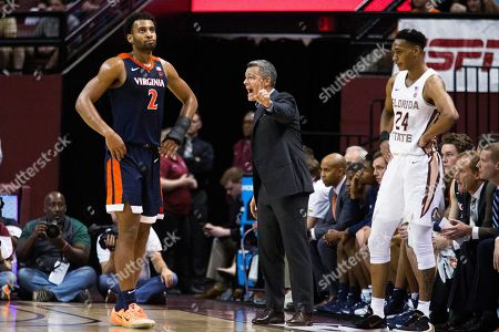 Virginia head coach Tony Bennett shouts instructions during the first half of the team's NCAA college basketball game against Florida State in Tallahassee, Fla