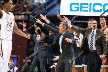 Virginia coach Tony Bennett and staff react to a call in the second half of the team's NCAA college basketball game against Florida State in Tallahassee, Fla., . Florida State won 54-50