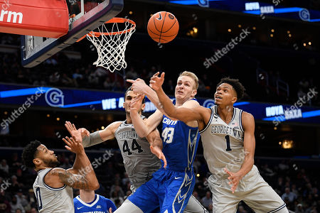 Creighton center Kelvin Jones (43) battles for the ball next to Georgetown forward Jamorko Pickett (1), center Omer Yurtseven (44) and guard Jahvon Blair (0) during the first half of an NCAA college basketball game, in Washington