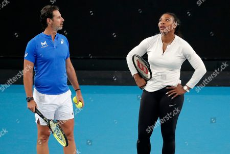 United States' Serena Williams and her coach Patrick Mouratoglou react during a practice session ahead of the Australian Open tennis championship in Melbourne, Australia