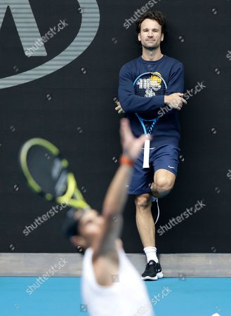 Carlos Moya coach of Spain's Rafael Nadal watches him practice on Rod Laver Arena ahead of the Australian Open tennis championship in Melbourne, Australia