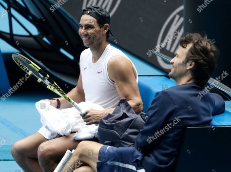Spain's Rafael Nadal, left, talks with his coach Carlos Moya during a training session on Rod Laver Arena ahead of the Australian Open tennis championship in Melbourne, Australia