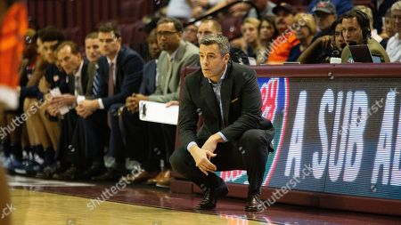 Stock Photo of Virginia head coach Tony Bennett watches in the first half of an NCAA college basketball game against Florida State in Tallahassee, Fla
