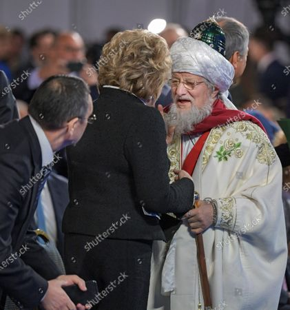 Chairman of the Federation Council Valentina Matviyenko (center) and Chairman of the Central Muslim Spiritual Board of Russia Talgat Tadzhuddin (right) before the speech of the Russian President.