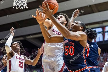 Alabama forward Alex Reese (3) and Auburn center Austin Wiley (50) chase a rebound during the first half of an NCAA college basketball game, in Tuscaloosa, Ala