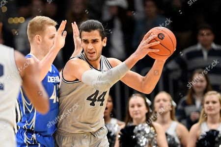 Georgetown center Omer Yurtseven (44) handles the ball next to Creighton center Kelvin Jones (43) during the first half of an NCAA college basketball game, in Washington