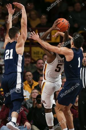 Stock Image of Minnesota's Marcus Carr holds on to the ball next to Penn State's Seth Lundy, right, during the second half of an NCAA college basketball game, in Minneapolis. Minnesota won 75-69