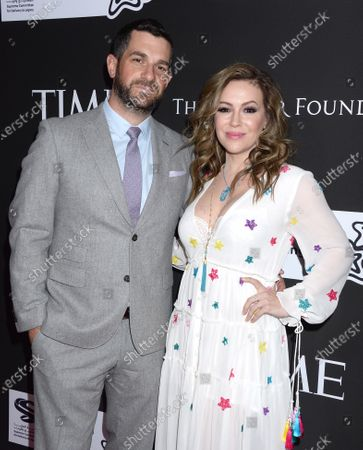 Alyssa Milano and husband Dave Bugliari