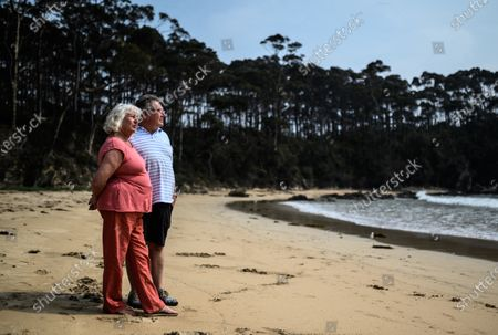 Stock Photo of Vanessa Williams (L) and Peter Williams (R) pose for a portrait on Lilli Pilli Beach, near where they have been living since losing their home in the New Years Eve bushfires, in Mogo, Australia, 16 January 2020. Bushfires swept through Mogo on New Years Eve 2019 destroying several homes and businesses. Peter and Vanessa Williams lost both their home and their business which were adjacent to eachother in Mogo.