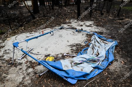 Stock Image of The remains of Peter and Vanessa Williams' home which was destroyed in the New Years Eve bushfire, in Mogo, Australia, 15 January 2020 (issued 16 January 2020). Bushfires swept through Mogo on New Years Eve 2019 destroying several homes and businesses. Peter and Vanessa Williams lost both their home and their business which were adjacent to eachother in Mogo.