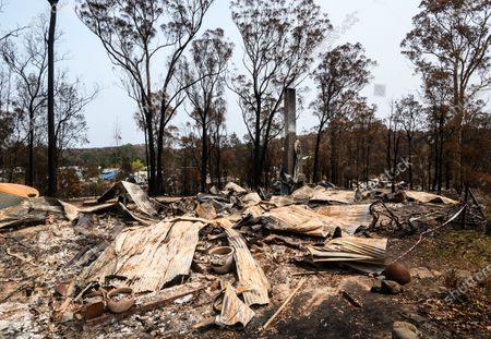 The remains of Peter and Vanessa Williams' home which was destroyed in the New Years Eve bushfire, in Mogo, Australia, 15 January 2020 (issued 16 January 2020). Bushfires swept through Mogo on New Years Eve 2019 destroying several homes and businesses. Peter and Vanessa Williams lost both their home and their business which were adjacent to eachother in Mogo.