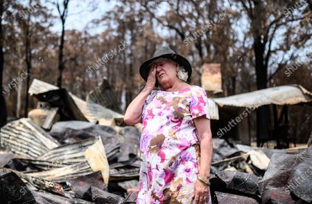Stock Picture of Vanessa Williams stands on the remains of Mogo Pottery, the business she ran with her husband Peter Williams (not pictured), in Mogo, Australia, 15 January 2020 (issued 16 January 2020). Bushfires swept through Mogo on New Years Eve 2019 destroying several homes and businesses. Peter and Vanessa Williams lost both their home and their business which were adjacent to eachother in Mogo.