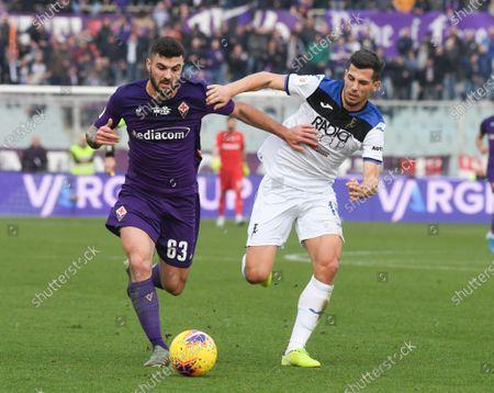 Patrick Cutrone of Fiorentina and Remo Freuler of Atalanta