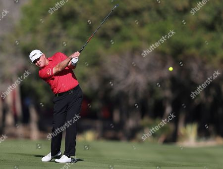 Scotland's Paul Lawrie plays a shot on the 14th fairway during first round one of the Abu Dhabi Championship golf tournament in Abu Dhabi, United Arab Emirates