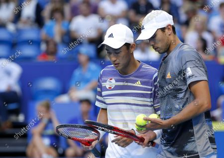 Stock Photo of Spain v Japan - Ben McLachlan and Go Soeda of Japan talk during the doubles against Spain