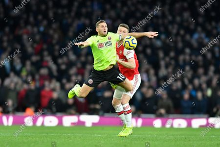 18th January 2020, Emirates Stadium, London, England; Premier League, Arsenal v Sheffield United : Billy Sharp (10) of Sheffield United flying through the air as Shkodran Mustafi (20) of Arsenal gives away a foul