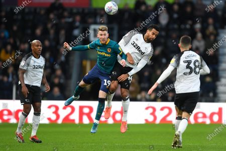 Stock Image of 18th January 2020, Pride Park Stadium, Derby, England; Sky Bet Championship, Derby County v Hull City : Josh Bowler (19) of Hull City battles with Tom Huddlestone (44) of Derby County 