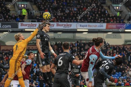 Stock Picture of 19th January 2020, Turf Moor, Burnley, England; Premier League, Burnley v Leicester City : Kasper Schmeichel (1) of Leicester City punches clear at the same time as Caglar Soyuncu (4) of Leicester City tries to head clear Credit: Mark Cosgrove/News Images