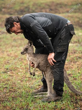 Gary Henderson holds a young injured kangaroo which he and his partner Sara Tilling are nursing back to health in Cobargo, Australia, 16 January 2020. Henderson and Tilling used to run the Cobargo Wildlife Sanctuary from their home, which was lost in a bushfire along with all their animals, and have only been able to rescue one kangaroo. Bushfires swept through Cobargo on New Year's Eve 2019 killing two and destroying several homes and businesses.