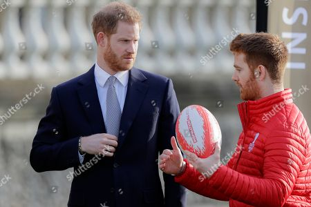 Prince Harry listens to Rugby League World Cup 2021 (RLWC2021) ambassador James Simpson in the gardens at Buckingham Palace in London,. Prince Harry will host the Rugby League World Cup 2021 draw at Buckingham Palace, prior to the draw, The Duke met with representatives from all 21 nations taking part in the tournament, as well as watching children from a local school play rugby league in the Buckingham Palace gardens