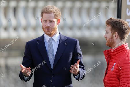 Prince Harry gestures next to Rugby League World Cup 2021 (RLWC2021) ambassador James Simpson in the gardens at Buckingham Palace in London,. Prince Harry will host the Rugby League World Cup 2021 draw at Buckingham Palace, prior to the draw, The Duke met with representatives from all 21 nations taking part in the tournament, as well as watching children from a local school play rugby league in the Buckingham Palace gardens