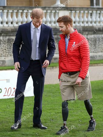 Prince Harry walks with Rugby League World Cup 2021 ambassador James Simpson in the gardens at Buckingham Palace in London,. Prince Harry will host the Rugby League World Cup 2021 draw at Buckingham Palace, prior to the draw, The Duke met with representatives from all 21 nations taking part in the tournament, as well as watching children from a local school play rugby league in the Buckingham Palace gardens