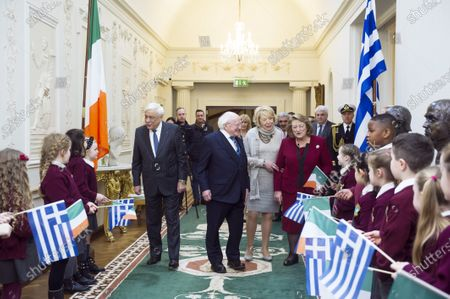 Greek President Prokopis Pavlopoulos (L) and his wife Vlassia Pavlopoulou-Peltsemi (R) with Irish President Michael D. Higgins (2-L) and Irish First lady Sabina Coyne (2-R) during a meeting with children at the President's Residence in Dublin, Ireland, 16 January 2020. The Greek president is on a state visit to Ireland.