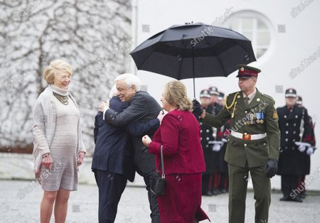 Irish President Michael D. Higgins (2-L) and Irish First lady Sabina Higgins (L) welcome Greek President Prokopis Pavlopoulos (C) and his wife Vlassia Pavlopoulou-Peltsemi (2-R) at the President's Residence in Dublin, Ireland, 16 January 2020. The Greek president is on a state visit to Ireland.