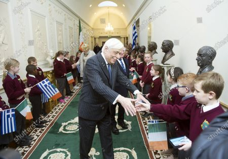 Greek President Prokopis Pavlopoulos (C) greets children during a meeting at the President's Residence in Dublin, Ireland, 16 January 2020. The Greek president is on a state visit to Ireland.