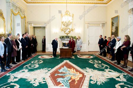 Irish President Michael D. Higgins (L) and Irish First lady Sabina Higgins (R) look as Greek President Prokopis Pavlopoulos (2-L) signs a visitors book next to his wife Vlassia Pavlopoulou-Peltsemi (2-R) at the President's Residence in Dublin, Ireland, 16 January 2020. The Greek president is on a state visit to Ireland.