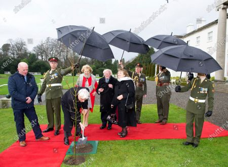 Greek President Prokopis Pavlopoulos (3-L), his wife Vlassia Pavlopoulou (6-L), Irish President Michael D. Higgins (5-L), and his wife Sabina Higgins (4-L) plant a tree at the President's Residence in Dublin, Ireland, 16 January 2020. The Greek president is on a state visit to Ireland.