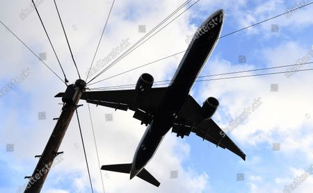 Stock Image of A passenger aircraft flies over a residential area as it prepares to land at Heathrow Airport in London, Britain, 16 January 2020. The owner of British Airways, International Airlines Group (IAG), on 15 January filed a complaint to the EU over the British Government's 120-million-euro bail-out plan for the UK regional airline Flybe. Willie Walsh, Chief Executive of IAG, said the bail-out would be a 'blatant misuse of public funds'.
