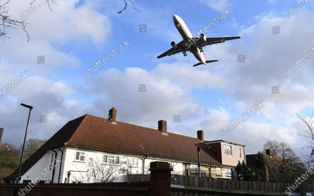 A passenger aircraft flies over a residential area as it prepares to land at Heathrow Airport in London, Britain, 16 January 2020. The owner of British Airways, International Airlines Group (IAG), on 15 January filed a complaint to the EU over the British Government's 120-million-euro bail-out plan for the UK regional airline Flybe. Willie Walsh, Chief Executive of IAG, said the bail-out would be a 'blatant misuse of public funds'.