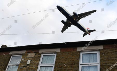 A British Airways (BA) aircraft flies over a residential area as it prepares to land at Heathrow Airport in London, Britain, 16 January 2020. The owner of British Airways, International Airlines Group (IAG), on 15 January filed a complaint to the EU over the British Government's 120-million-euro bail-out plan for the UK regional airline Flybe. Willie Walsh, Chief Executive of IAG, said the bail-out would be a 'blatant misuse of public funds'.