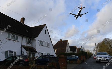 Stock Photo of A British Airways (BA) aircraft flies over a residential area as it prepares to land at Heathrow Airport in London, Britain, 16 January 2020. The owner of British Airways, International Airlines Group (IAG), on 15 January filed a complaint to the EU over the British Government's 120-million-euro bail-out plan for the UK regional airline Flybe. Willie Walsh, Chief Executive of IAG, said the bail-out would be a 'blatant misuse of public funds'.