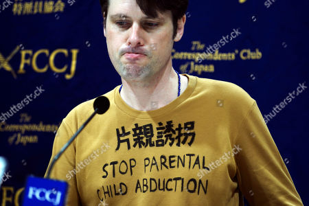"Tokyo-based Australian journalist Scott McIntyre speaks during a press conference at Foreign Correspondent's Club Japan in Tokyo . McIntyre said he is a victim of ""inhumane"" custody laws that allow only one side of the parents access to children of broken marriages, the day after he was convicted of trespassing at the apartment building of his estranged wife's in-laws for trying to find his children"