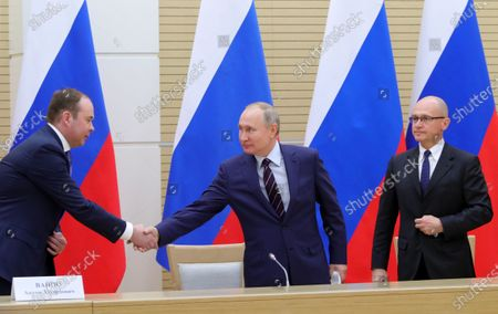 Stock Photo of Russian President Vladimir Putin (C) shakes hands with Chief of Staff of the Presidential Executive Office Anton Vaino (L) as First Deputy Chief of Staff of the Presidential Office Sergei Kiriyenko (R) looks on before a meeting to prepare amendments to the Russian constitution at Novo-Ogaryovo residence outside Moscow, Russia, 16 January 2020. The constitutional amendments were proposed by Vladimir Putin in address to the Federal Assembly 15 January 2020.