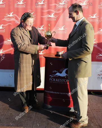 Paul Henderson Owner And Trainer Of The Race Winner Lidjo De Rouge Is Presented With The Trophy By Vyvyan Harmsworth horse Racing Daily Mail Race Day At Folkestone  In Memory Of Lady Harmsworth.