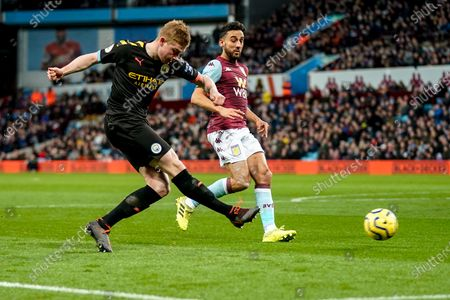 Stock Image of Kevin De Bruyne of Manchester City takes a shot at goal as El Mohamady of Villa closes in