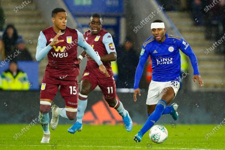 Ricardo Pereira of Leicester City on the ball covered by Konsa of Villa