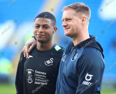 Rhian Brewster of Swansea City with former Swansea City player and current first-team coach Alan Tate