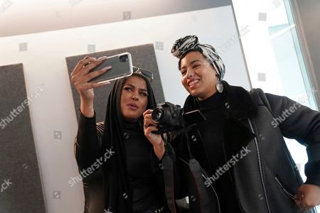 Amani Al-Khatahtbeh, left, films a video with Maryam Saad after recording a podcast pilot at Spotify's headquarters in New York. Al-Khatahtbeh started the website as a way to defy Muslim stereotypes after 9/11. A decade later, Al-Khatahtbeh has built it into an online magazine with a global audience