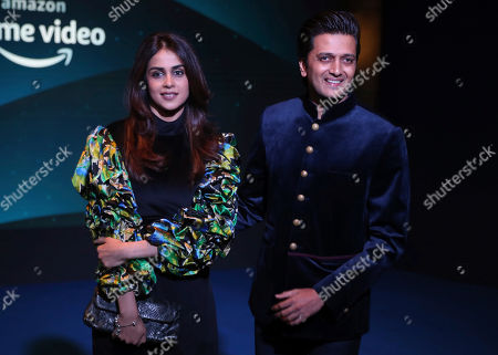 Stock Picture of Bollywood actor Riteish Deshmukh, right, along with Genelia D'Souza poses for photographs during a blue carpet event organized by Amazon Prime Video in Mumbai, India