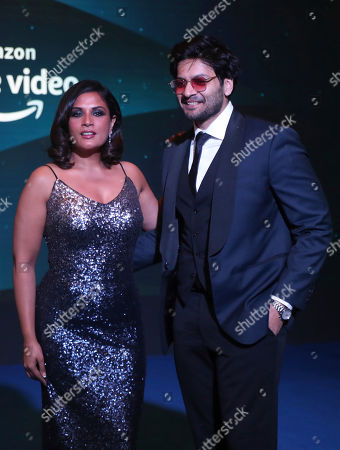 Stock Photo of Bollywood actress Richa Chadda, left, along with Ali Fazal poses for photographs during a blue carpet event organized by Amazon Prime Video in Mumbai, India