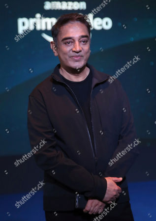 Indian actor Kamal Haasan poses for photographs during a blue carpet event organized by Amazon Prime Video in Mumbai, India