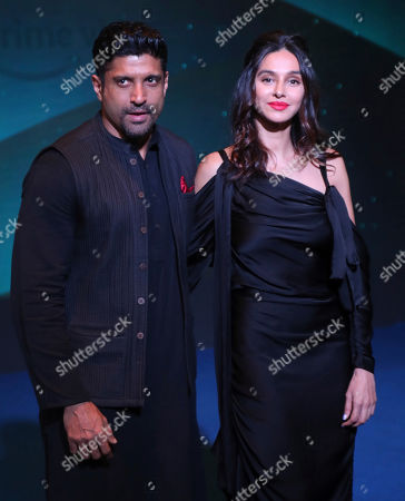 Bollywood actor Farhan Akhtar, left, along with Shibani Dandekar poses for photographs during a blue carpet event organized by Amazon Prime Video in Mumbai, India